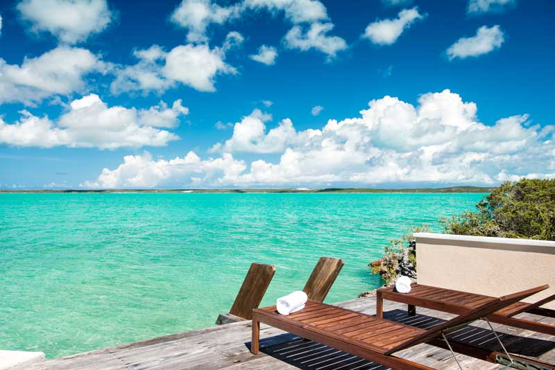 Book a Turks and Caicos Villa at Emerald-Shores. Dock,-Ladder-and-Lounge-Chairs