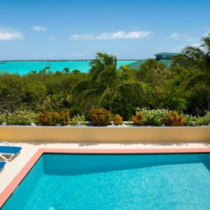 Emerald-Shores-Guesthouse-Pool-with-Chalk-Sound-and-Main-House-in-the-Distance